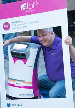 man with robot, in selfie booth in social media tent